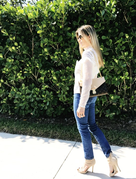 A textured top from Self-Portrait is paired with AG Adriano Goldshmied denim and neutral heels.