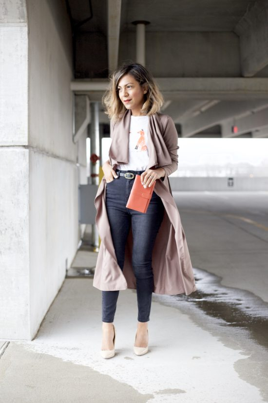 This pink jacket is the perfect, light layer for spring and summer. It is similar to the one worn by Hannah Jeter.