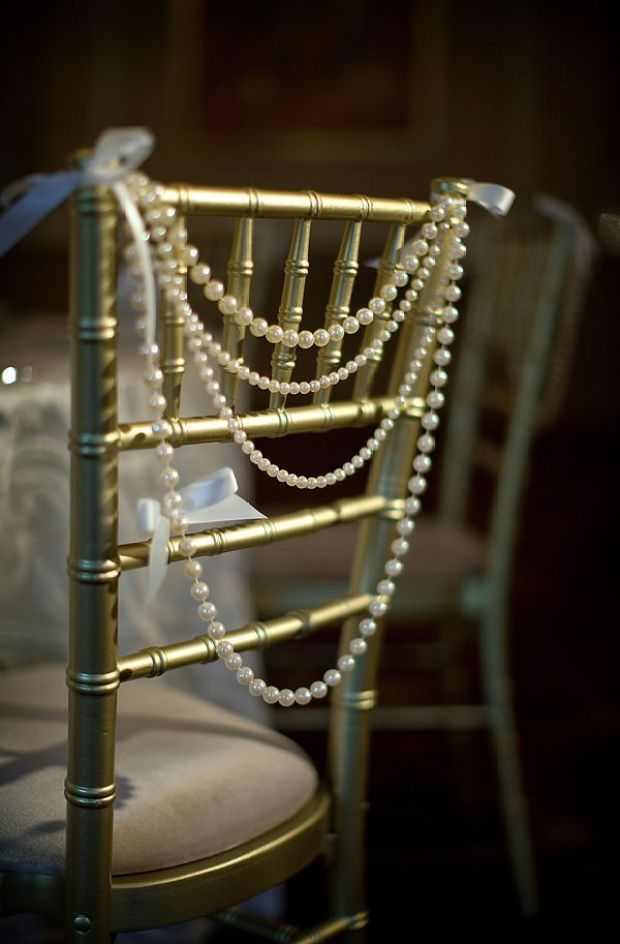 vintage-wedding-decor-ideas-pearls-decorate-chairs