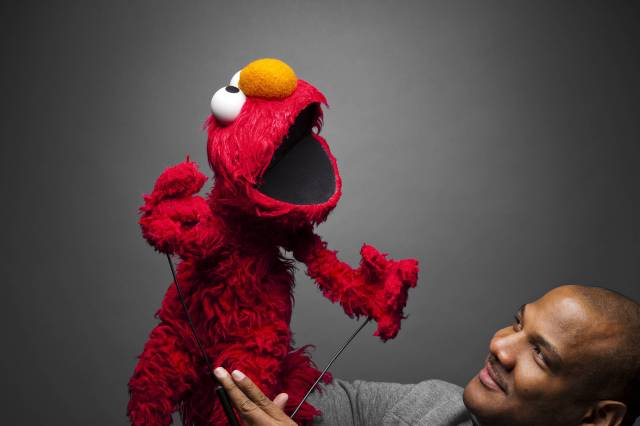 "Elmo and Kevin Clash promoting ""Being Elmo"" at the Sundance 2011 Moving Pictures Media Studio. Make-up by MAC Cosmetics."