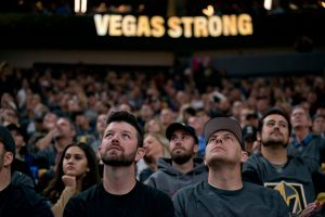 Fans at Golden Knights Game with Vegas Strong in background