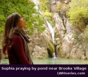Sophia praying by pond near Brooks Village, seeking God's purpose