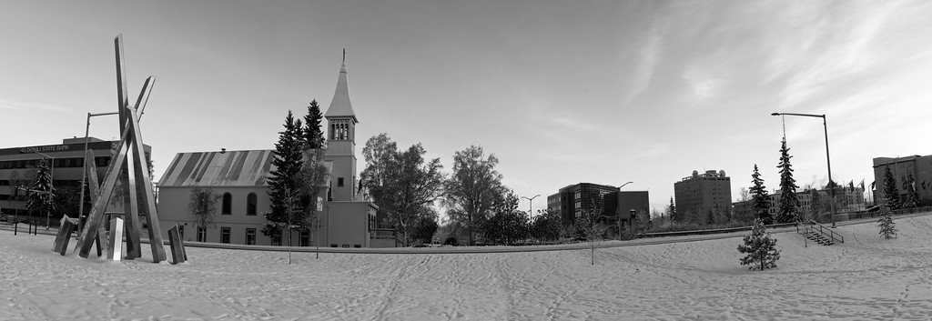 """Panorama of the new Polaris sculpture and Immaculate Conception Church and the downtown Fairbanks """"skyline"""". Nice warm light in the early afternoon."""