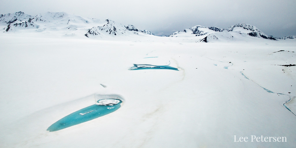 blue lakes on the Black Rapids Glacier