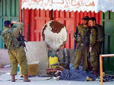 israeli soldiers have their picture taken with their dead palestinian 'trophy' (library photo)