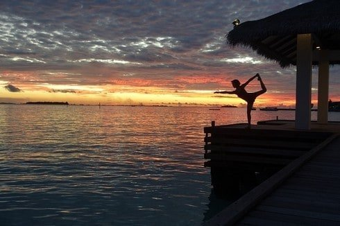 Yoga with the blazing sunset at Sheraton Maldives