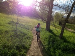 One of the kiddos I coach riding into the sunrise