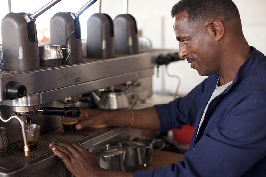 A barista operates an espresso machine in Harar, Ethiopia.
