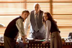 """Warner Bros. Pictures [From left] Jimmy Olsen (Sam Huntington), Perry White (Frank Langella) and Lois Lane (Kate Bosworth) discuss the sudden reappearance of the Man of Steel in Warner Bros. Pictures' and Legendary Pictures' action adventure """"Superman Returns."""""""