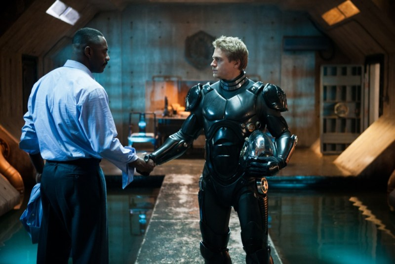 Kerry Hayes/ Warner Bros. Pictures Stacker Pentecost (Idris Elba) and Raleigh Becket (Charlie Hunnam)