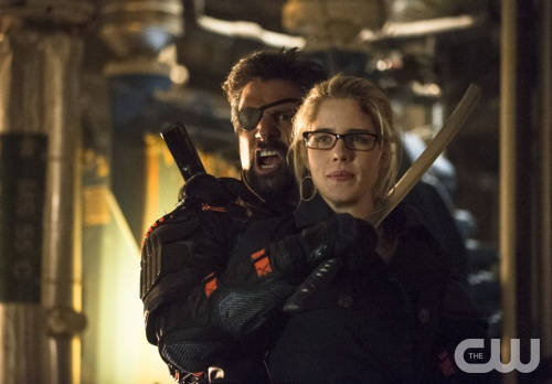 Cate Cameron/The CW Manu Bennett as Slade Wilson and Emily Bett Rickards as Felicity Smoak