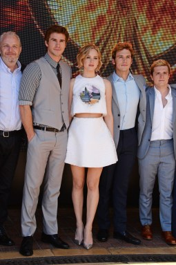 "David M. Benett/Getty Images (L to R) Director Francis Lawrence, Liam Hemsworth, Jennifer Lawrence, Sam Claflin and Josh Hutcherson appear at Lionsgate's ""The Hunger Games: Mockingjay Part 1"" photocall."