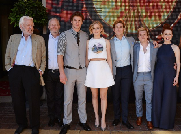 "David M. Benett/Getty Images (L to R) Donald Sutherland, director Francis Lawrence, Liam Hemsworth, Jennifer Lawrence, Sam Claflin, Josh Hutcherson and Julianne Moore appear at Lionsgate's ""The Hunger Games: Mockingjay Part 1"" photocall at the Majestic Barriere on May 17, 2014 in Cannes, France."