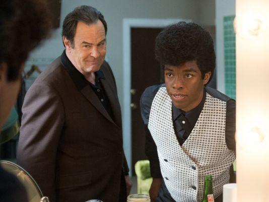 "D. Stevens/Universal Pictures Ben Bart (Dan Aykroyd) and James Brown (Chadwick Boseman) in ""Get on Up""."