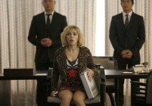 Jessica Forde/Universal Studios Lucy (Scarlett Johansson) is temporarily held hostage by thugs