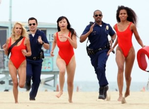 let's be cops - jake johnson and damon wayans jr. with female lifeguards