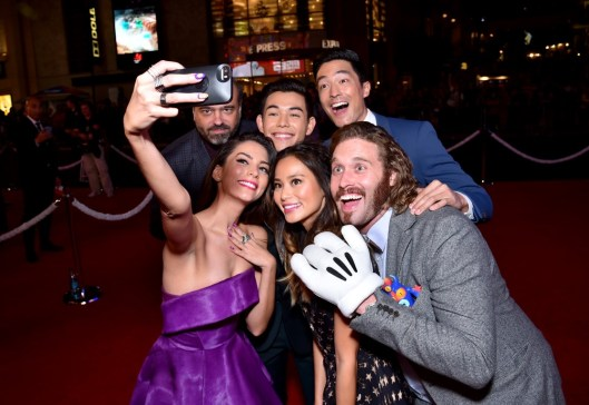 Alberto E. Rodriguez/Getty Images Genesis Rodriguez (left) takes a selfie with actors (from left) actors Scott Adsit, Ryan Potter, Jamie Chung, Daniel Henney and T.J. Miller.
