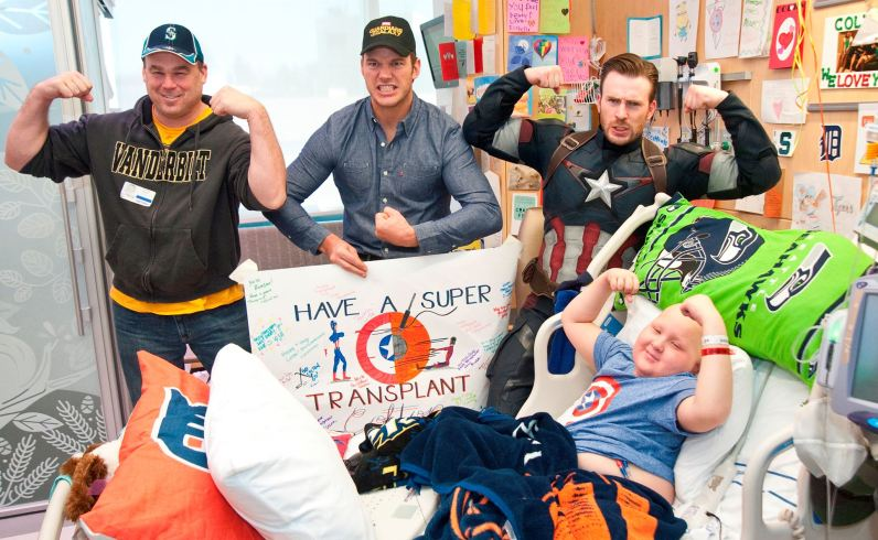 Chris Pratt and Chris Evans posing with pal at Seattle Children's Hospital