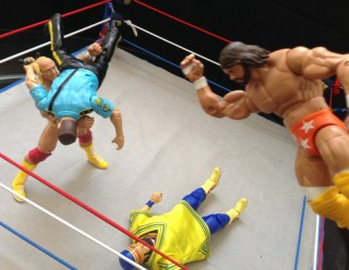 Hulk Hogan Defining Moments figure - Hogan slams Bossman Savage elbows Akeem