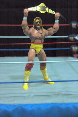 Hulk Hogan Defining Moments figure - holding title up