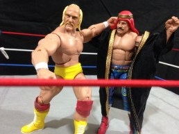 Hulk Hogan Defining Moments figure - sending Iron Shiek to turnbuckle