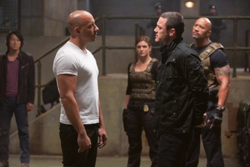 Giles Keyte/Universal Pictures Han (Sung Kang), Dom (Vin Diesel), Riley (Gina Carano), Shaw (Luke Evans) and Hobbs (Dwayne Johnson).