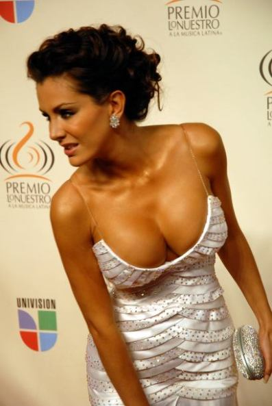 Ninel Conde - white and silver dress