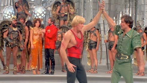 Flash Gordon - Vultan, Dale, Zarkov watch Flash and Prince Barin
