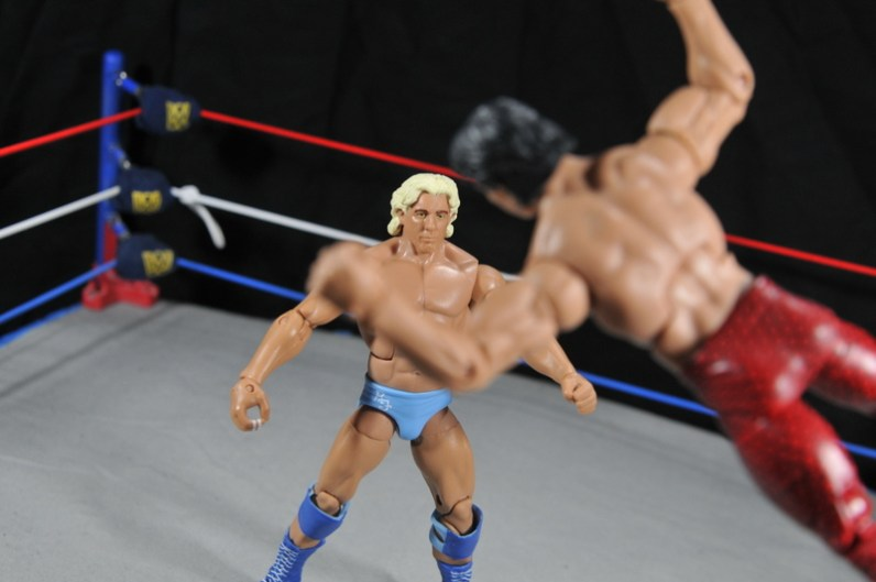 Ric Flair Defining Moments figure review - Ricky Steamboat dives at Flair