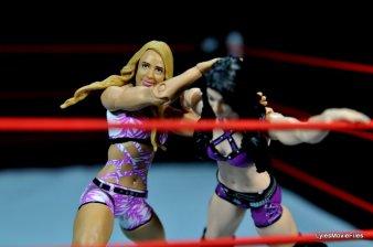 Emma WWE Mattel Basic 30 - grabbing Paige's head