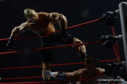 Mattel Brock Lesnar WWE figure - kicking Triple H in a corner