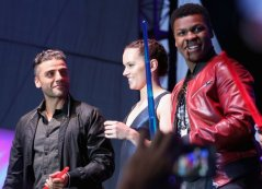 "SAN DIEGO, CA - JULY 10: (L-R) Actors Oscar Isaac, Daisy Ridley, John Boyge and more than 6000 fans enjoyed a surprise `Star Wars` Fan Concert performed by the San Diego Symphony, featuring the classic ""Star Wars"" music of composer John Williams, at the Embarcadero Marina Park South on July 10, 2015 in San Diego, California. (Photo by Jesse Grant/Getty Images for Disney) *** Local Caption *** Oscar Isaac; Daisy Ridley; John Boyega"