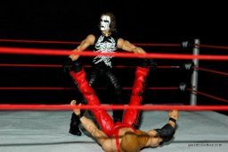 Sting figure WWE Mattel Defining Moments - about to put on the Scorpion Deathlock