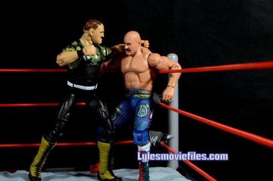 Sgt. Slaughter WWE Hall of Fame figure - punching Iron Sheik