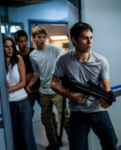 MAZE RUNNER: THE SCORCH TRIALSThomas (Dylan O'Brien, right) leads Teresa (Kaya Scodelario), Minho (Ki Hong Lee), and Newt (Thomas Brodie-Sangster) in a daring escape from WCKD.Photo credit: Richard Foreman, Jr. SMPSPTM and © 2015 Twentieth Century Fox Film Corporation. All Rights Reserved. Not for sale or duplication.