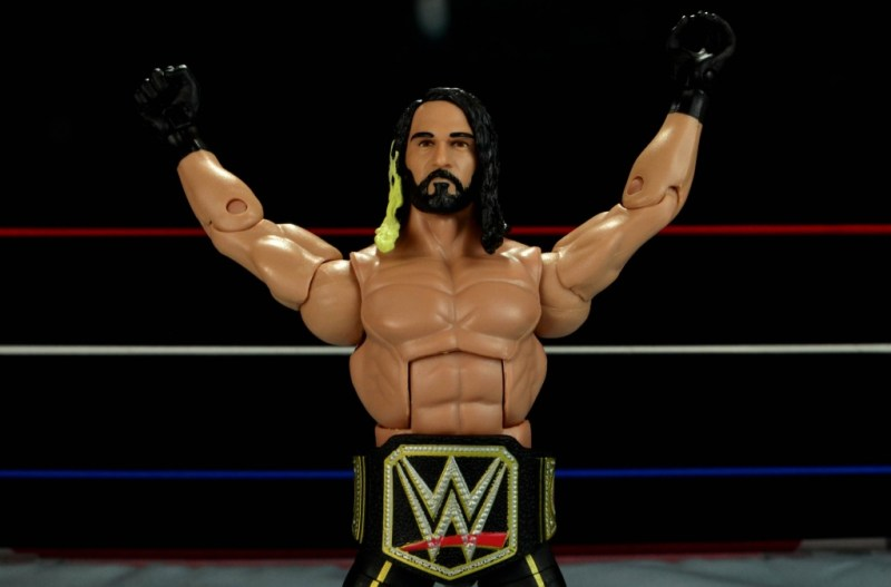 Seth Rollins Mattel exclusive -hands up wearing title belt