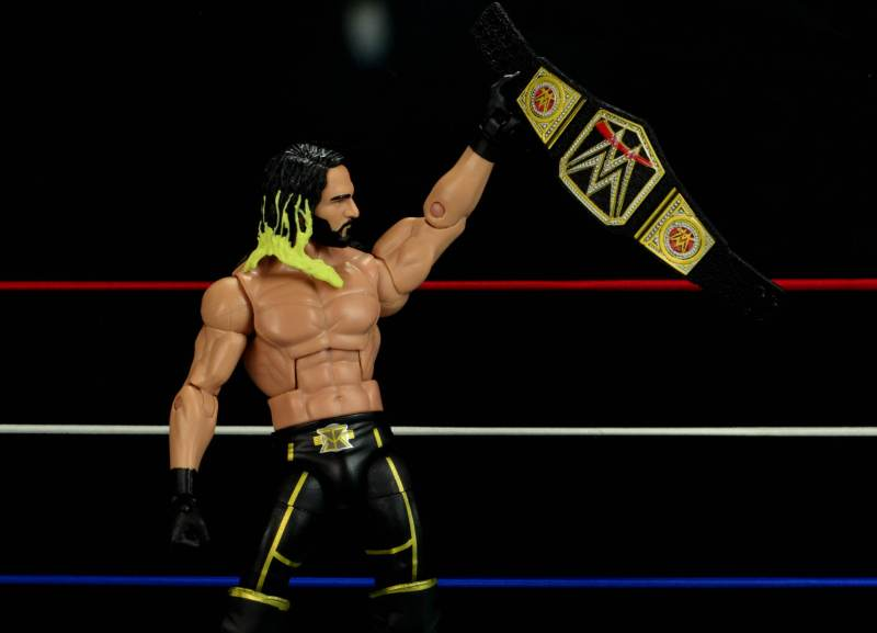 Seth Rollins Mattel exclusive -holding title belt after win