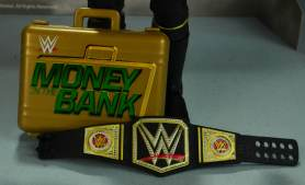 Seth Rollins Mattel exclusive - MITB briefcase and WWE title belt