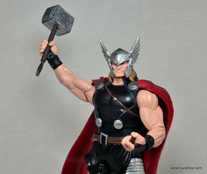 Marvel Legends Thor figure review -raising Mjlonir up