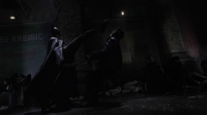 batman-1989-batman-kicking-bad-guy
