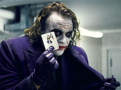 the-dark-knight-heath-ledger-joker-holding-a-card