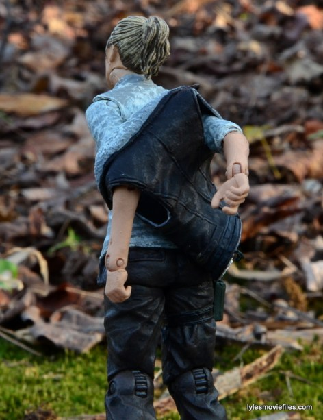 The Walking Dead Andrea figure review - putting vest on closeup