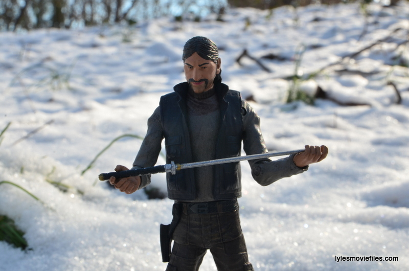 The Walking Dead The Governor McFarlane Toys review - The Governor holding Michonne's sword