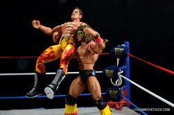 Ultimate Warrior Hall of Fame figure -atomic dropping Rick Rude
