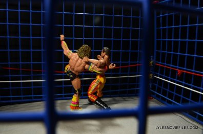 Ultimate Warrior Hall of Fame figure -cage fight with Rude close up