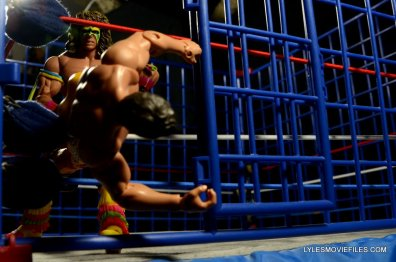 Ultimate Warrior Hall of Fame figure -grabbing Rude