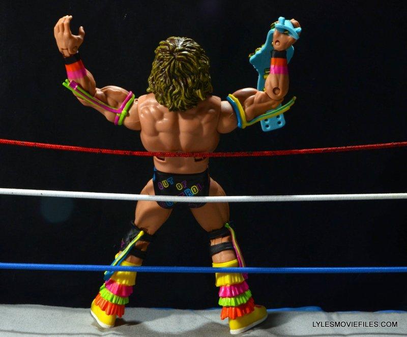 Ultimate Warrior Hall of Fame figure -holding belt