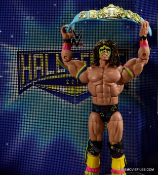 Ultimate Warrior Hall of Fame figure -wide against HOF backdrop