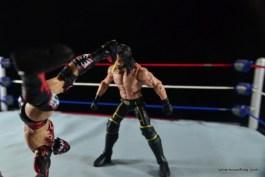 WWE Elite 41 Finn Balor -Pele kick to Seth Rollins