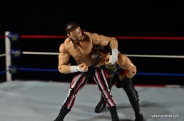 WWE Elite 41 Terry Funk figure review -headlock punching